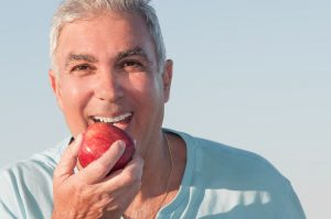 Eating Apple with Dental Implants
